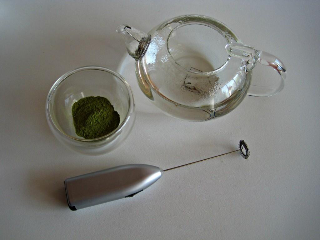 A Modern Take on Matcha Making- Matcha tea, hot water, and a small mixer